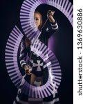 girl dancing light show | Shutterstock . vector #1369630886