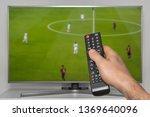 football match on tv and human... | Shutterstock . vector #1369640096
