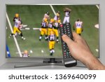 rugby match on tv and human... | Shutterstock . vector #1369640099