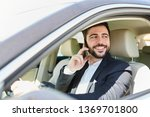 young businessman is phoning... | Shutterstock . vector #1369701800
