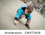 boy drawing on road. outdoor. | Shutterstock . vector #136971818