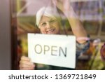 senior woman holding open sign... | Shutterstock . vector #1369721849