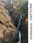 Waterfall Among Stone Rocks An...