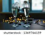 two champagne wine glasses and...   Shutterstock . vector #1369766159