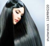 long straight hair. beautiful...   Shutterstock . vector #136984220