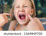 little girl points the finger...   Shutterstock . vector #1369849700