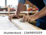 carpenter working on... | Shutterstock . vector #1369893359