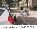 family on a bike ride on the... | Shutterstock . vector #1369979693