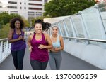 Happy young curvy women jogging ...