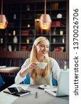 charming smiling blonde... | Shutterstock . vector #1370026706