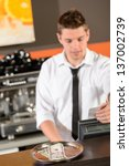 young bartender in uniform... | Shutterstock . vector #137002739