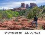 man hiking and enjoying the... | Shutterstock . vector #137007536