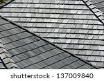 several angled rooftops with... | Shutterstock . vector #137009840