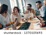 sharing ideas. group of young...   Shutterstock . vector #1370105693