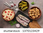 Stock photo traditional russian snacks and vodka sauerkraut with cranberries herring pickled cucumbers 1370123429