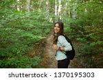 young woman taking a walk in... | Shutterstock . vector #1370195303