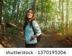 young woman taking a walk in... | Shutterstock . vector #1370195306
