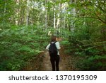young woman taking a walk in... | Shutterstock . vector #1370195309