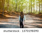young woman taking a walk in... | Shutterstock . vector #1370198390