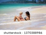 mother and child playing at... | Shutterstock . vector #1370388986