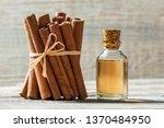 Close Up Bottle Of Cinnamon Oi...