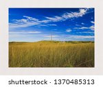A Warm Field Of Grass Beside A...
