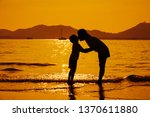a mother and son kiss on the... | Shutterstock . vector #1370611880