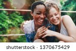 cheerful girls embracing each... | Shutterstock . vector #1370675429