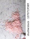 pink sea salt on a marble...   Shutterstock . vector #1370719589