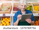 shop assistant with digital... | Shutterstock . vector #1370789756