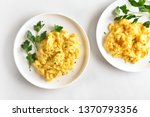 Scrambled Eggs On Plate Over...