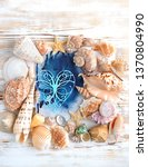Heart And Many Seashells On Old ...