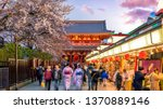 tourists at shopping street in... | Shutterstock . vector #1370889146
