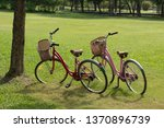 two bikes parked on the green... | Shutterstock . vector #1370896739