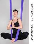 fly yoga. women practices... | Shutterstock . vector #1371052106
