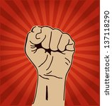 a clenched fist held high in... | Shutterstock .eps vector #137118290