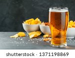 lager beer and snacks on stone...   Shutterstock . vector #1371198869