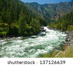 A River Flowing Through A...