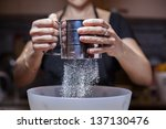 sifting flour into a bowl ... | Shutterstock . vector #137130476