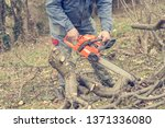 worker using chain saw and... | Shutterstock . vector #1371336080