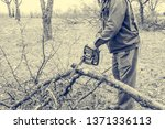 worker using chain saw and... | Shutterstock . vector #1371336113