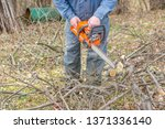 worker using chain saw and... | Shutterstock . vector #1371336140