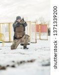 crouching position military and ...   Shutterstock . vector #1371339200