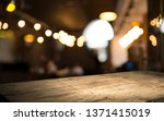 Stock photo blurred background of bar and dark brown desk space of retro wood 1371415019