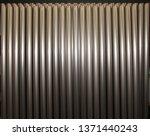 titanium tubes in rack | Shutterstock . vector #1371440243