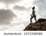young and sporty female hiker... | Shutterstock . vector #1371538580