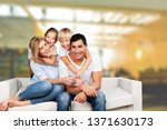 young family at home smiling at ... | Shutterstock . vector #1371630173
