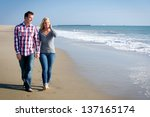 young couple walking on the... | Shutterstock . vector #137165174