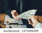businessman handed the money... | Shutterstock . vector #1371696509
