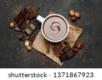 cup of hot chocolate and pieces ...   Shutterstock . vector #1371867923